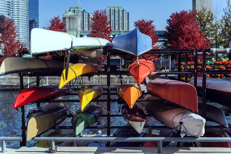 Racks of brightly colored kayaks and canoes on the Toronto waterfront