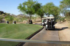 Parade of golf carts during a tournament with a shotgun start