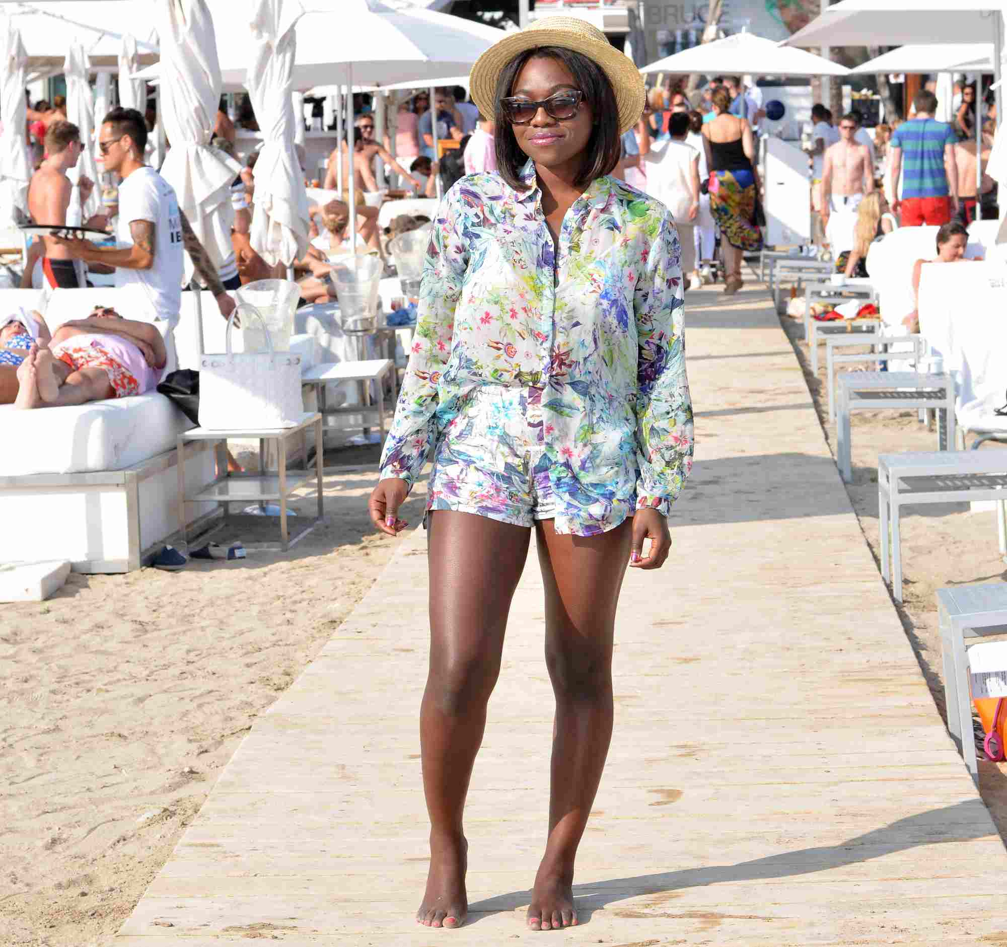 Woman in floral romper for beach fashion