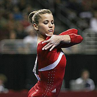 Alicia Sacramone poses on floor at the 2008 US Olympic Trials