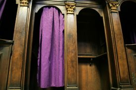 A Catholic confession booth with a purple curtain