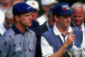 Lee Janzen of the USA poses with the trophy as Payne Stewart of the USA looks on. Janzen won the 1998 U.S. Open Championships