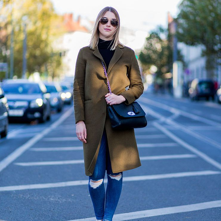 Street style coat and ripped jeans