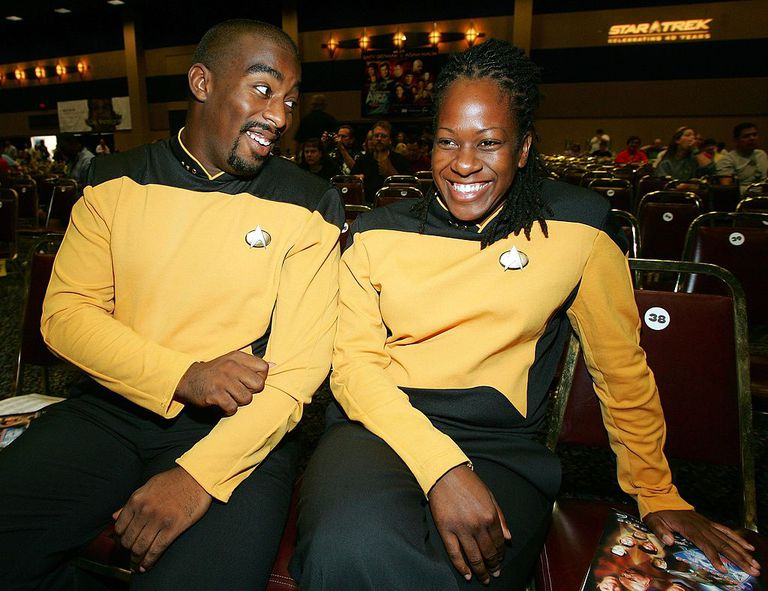 Man and woman in yellow Star Trek costumes