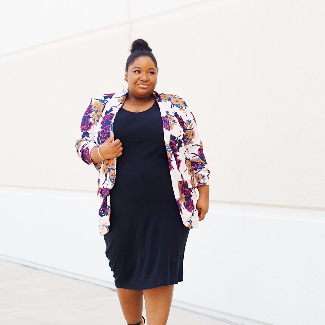 Woman in Black Dress and Floral Print Blazer