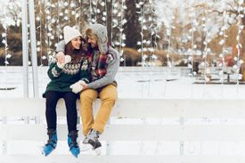 Young Couple in Love Is Enjoying Winter Day Skating
