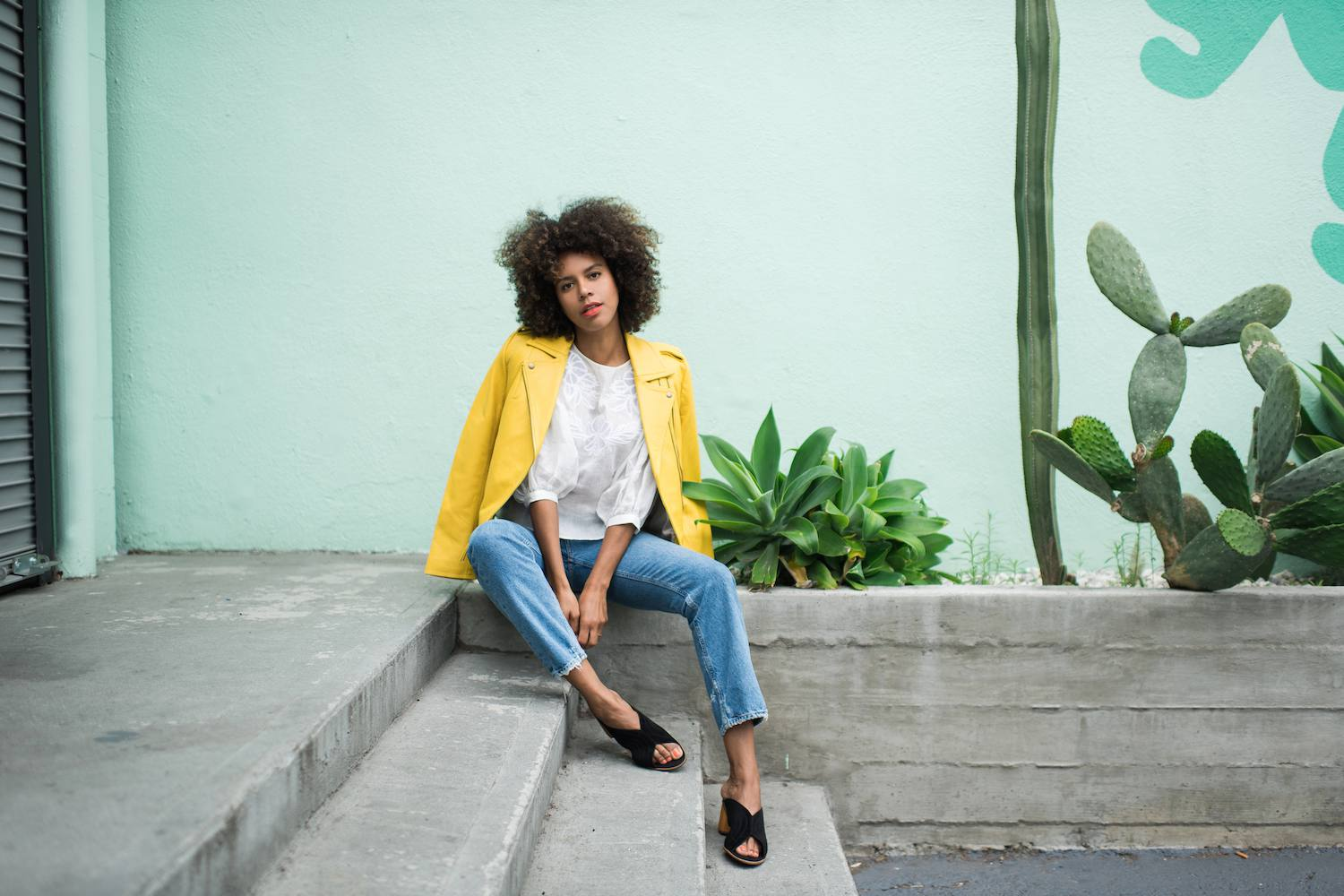 Woman in yellow leather jacket and jeans