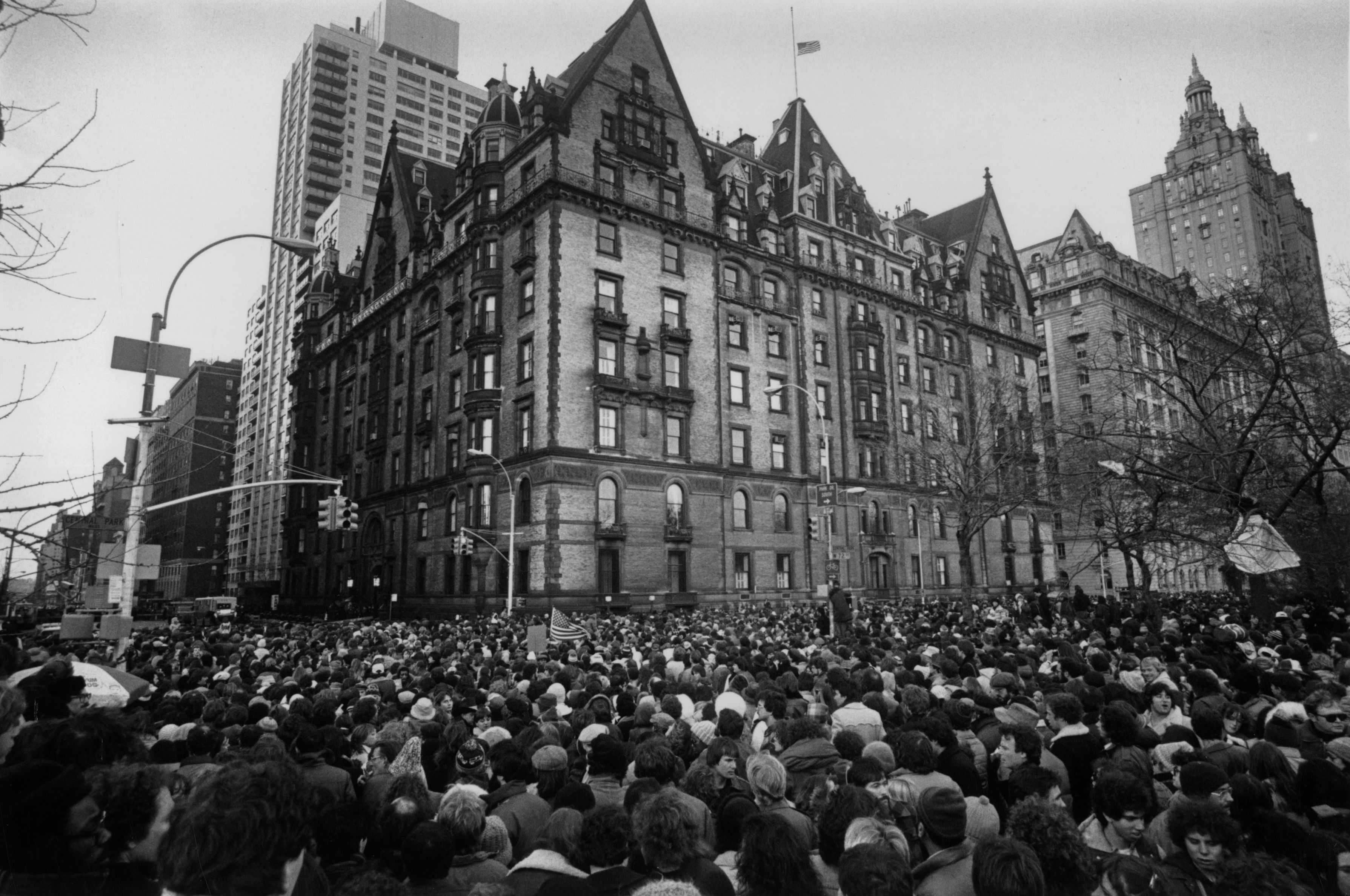 Crowds gathering outside the home of John Lennon