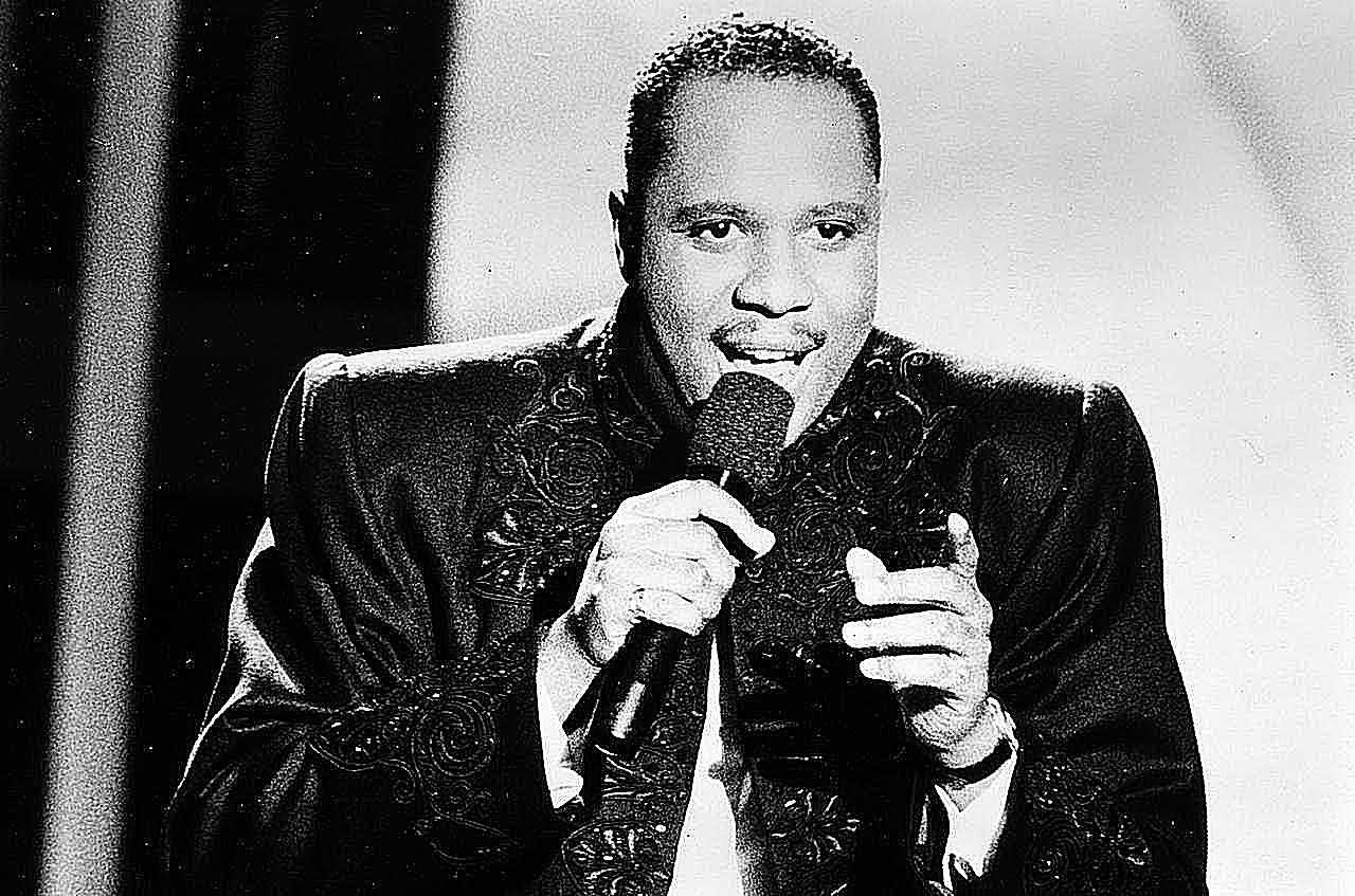Freddie Jackson, R&B soul singer, holding a microphone singing, 1991.