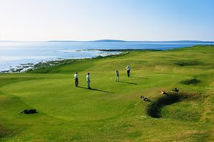 Four golfers playing at Ballybunion links in Ireland
