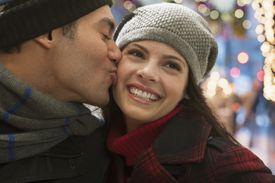 Mixed race man kissing girlfriend