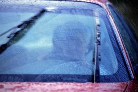 Windshield wipers working on car driving in the rain