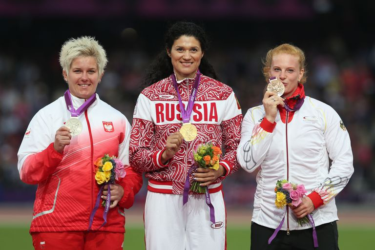 Tatyana Lysenko (center) earned the hammer throw gold medal at the 2012 Olympics. Anita Wlodarczyk (left) earned the silver medal and Betty Heidler (right) the bronze.