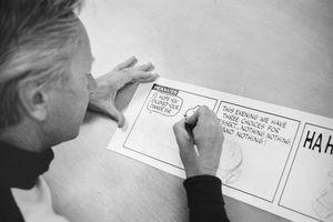 Charles Schlutz creating Peanuts strip
