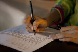 Woman's hand signing a contract