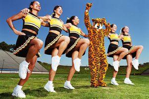 Scholastic cheerleaders performing