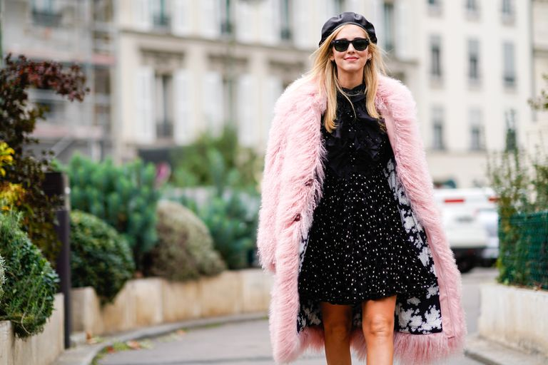 Street style in pink faux fur coat