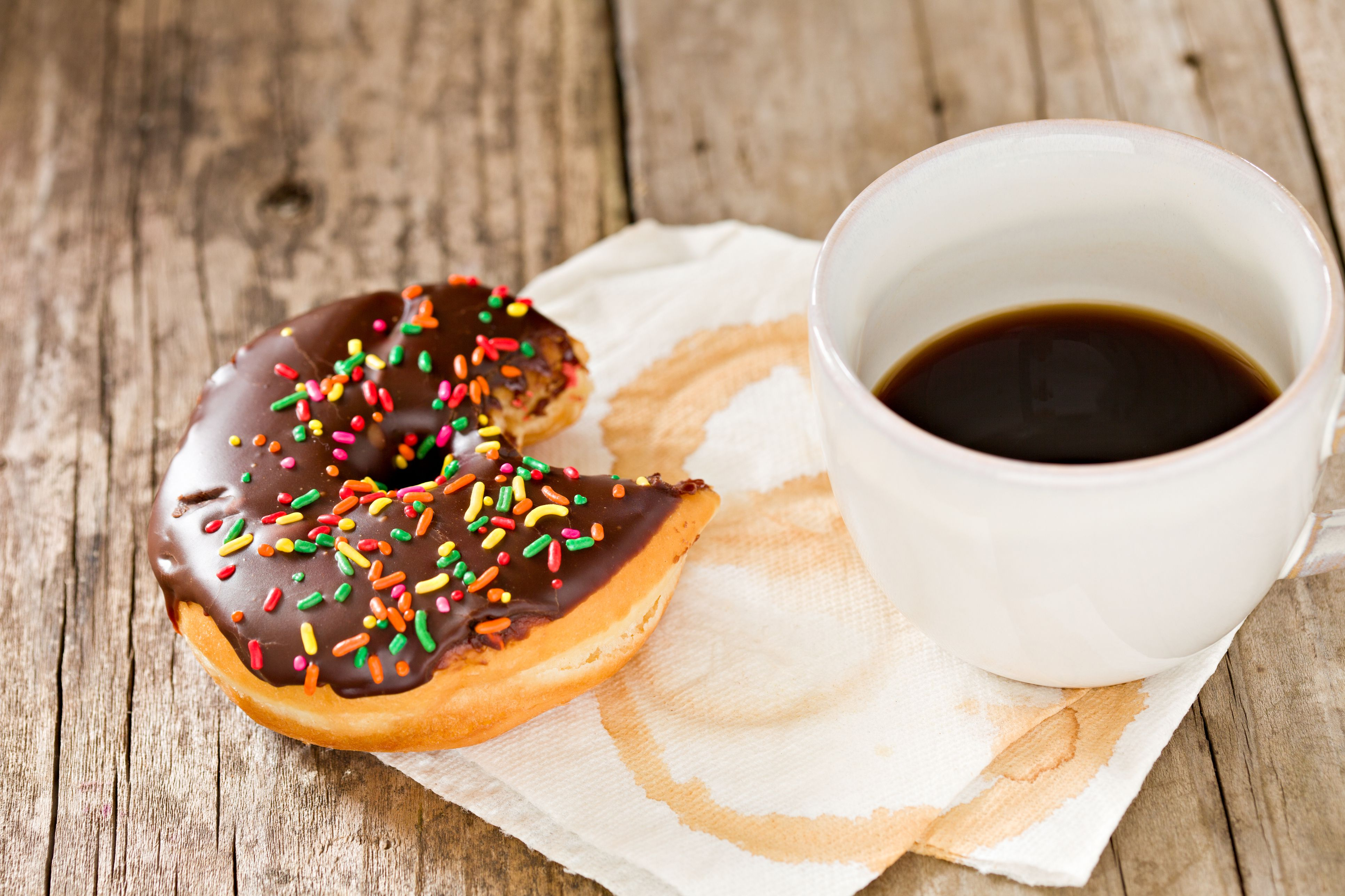 A cup of coffee and a donut.
