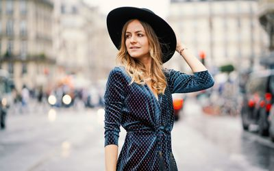 64359009c32ea9 Woman wearing a wide brim hat and polka dot dress