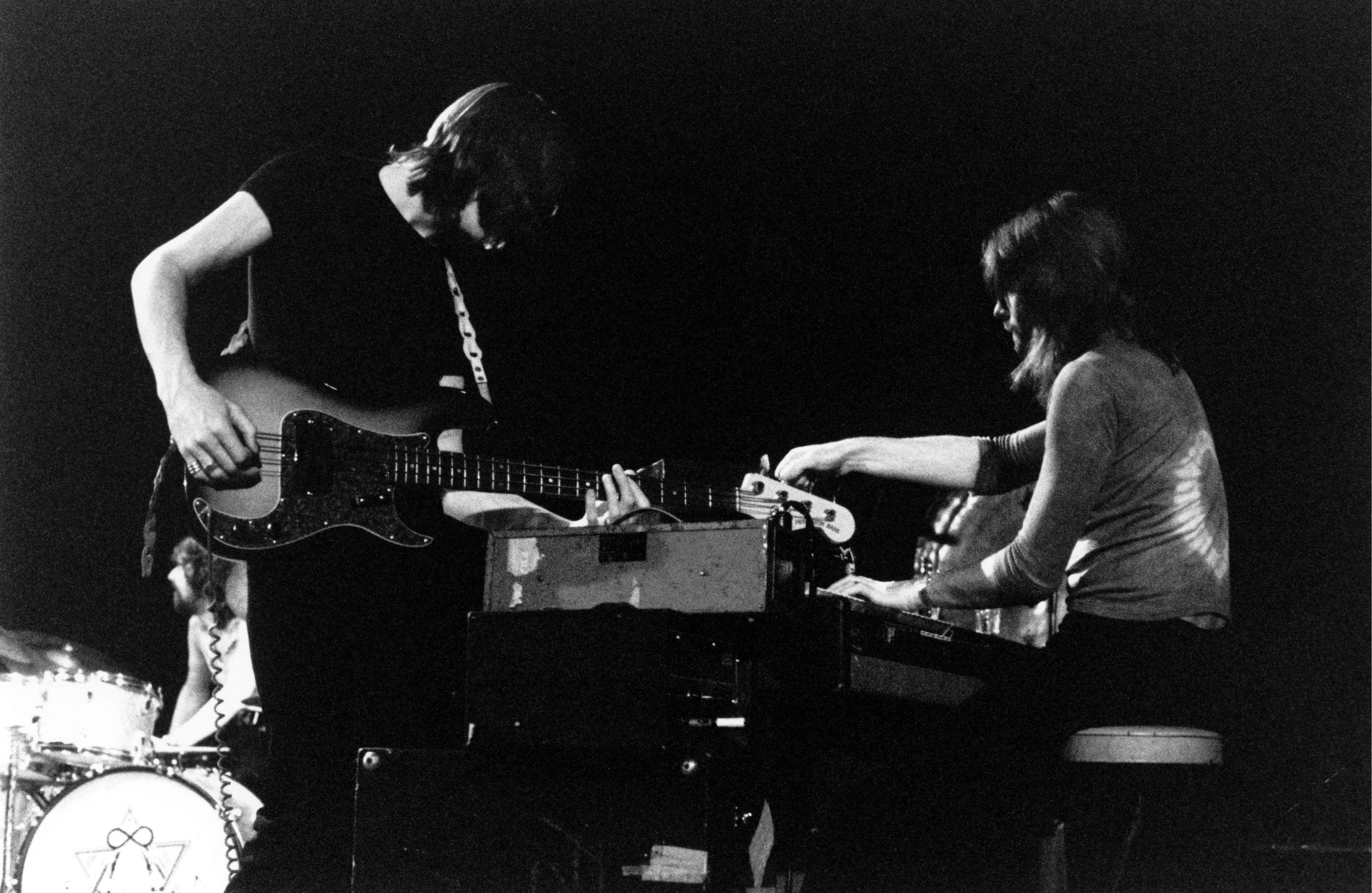 Pink Floyd performing; black and white photo