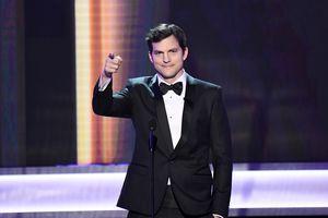 Ashton Kutcher presenting at an awards show