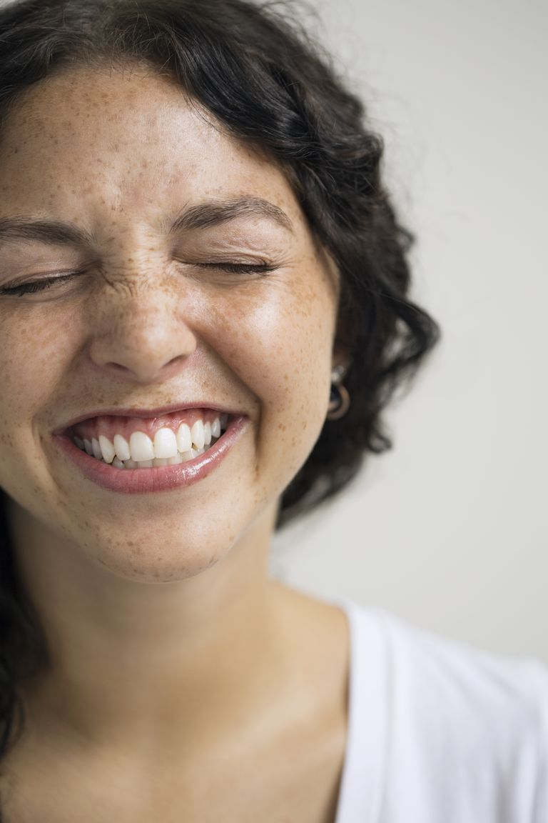 Close up of enthusiastic woman with eyes closed