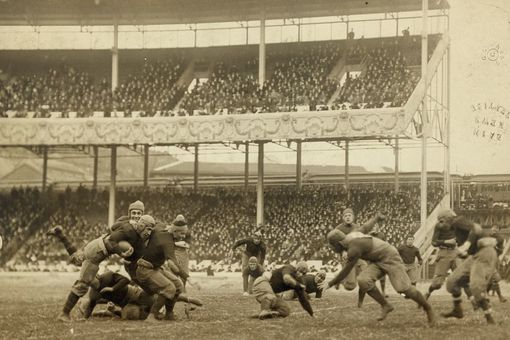January 1, 1916 football game between Army and Navy in New York, sepia photograph.