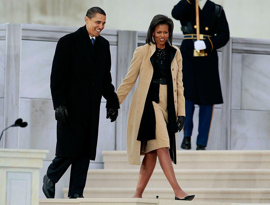 Barack and Michele Obama holding hands