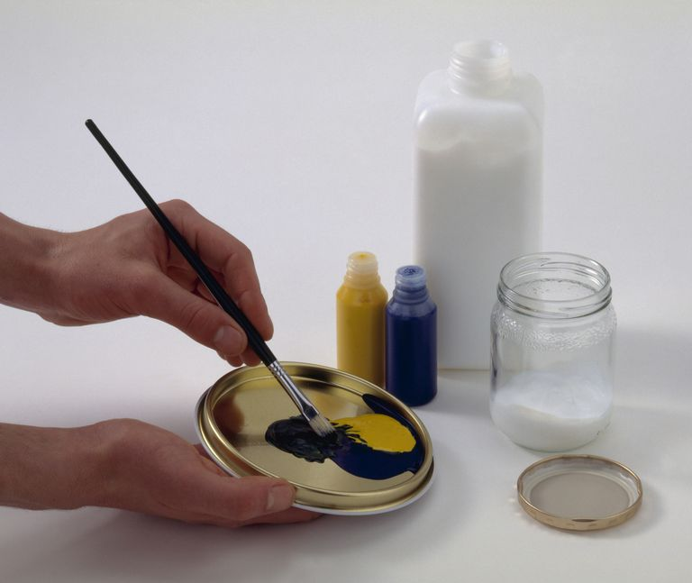 Mixing acrylic colours on the lid of a paint tin before adding to basic glaze in jar
