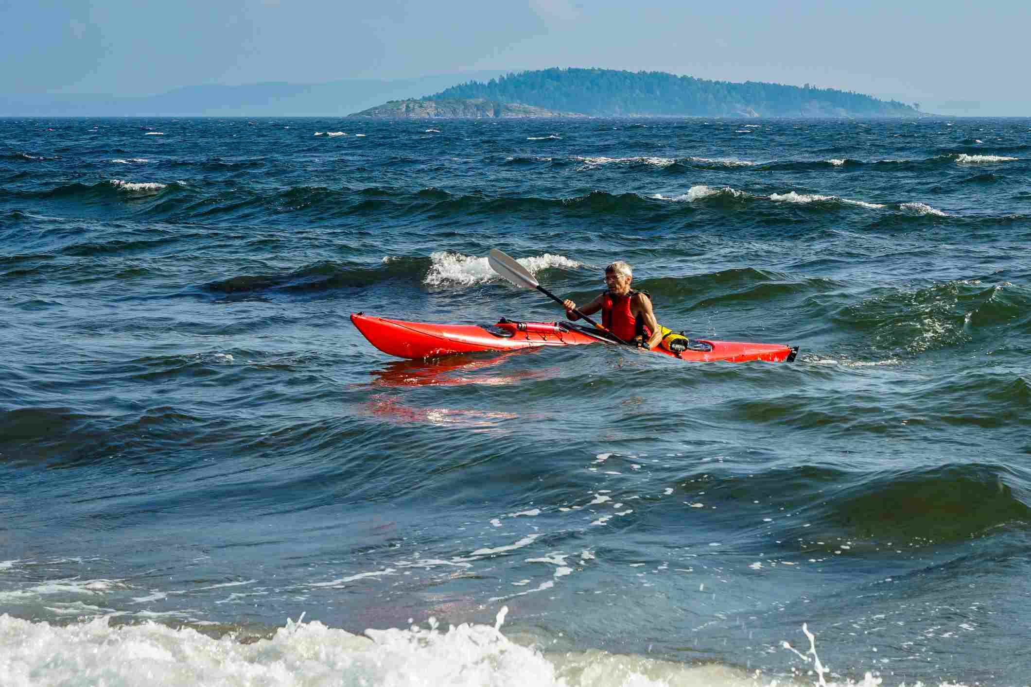 Kayak paddling at sea