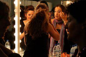actors applying stage makeup