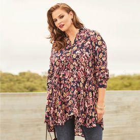 A woman wearing a paisley shirt outside