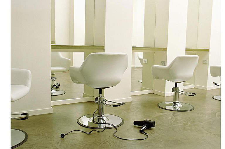 Empty Hair Salon Dryer On Floor