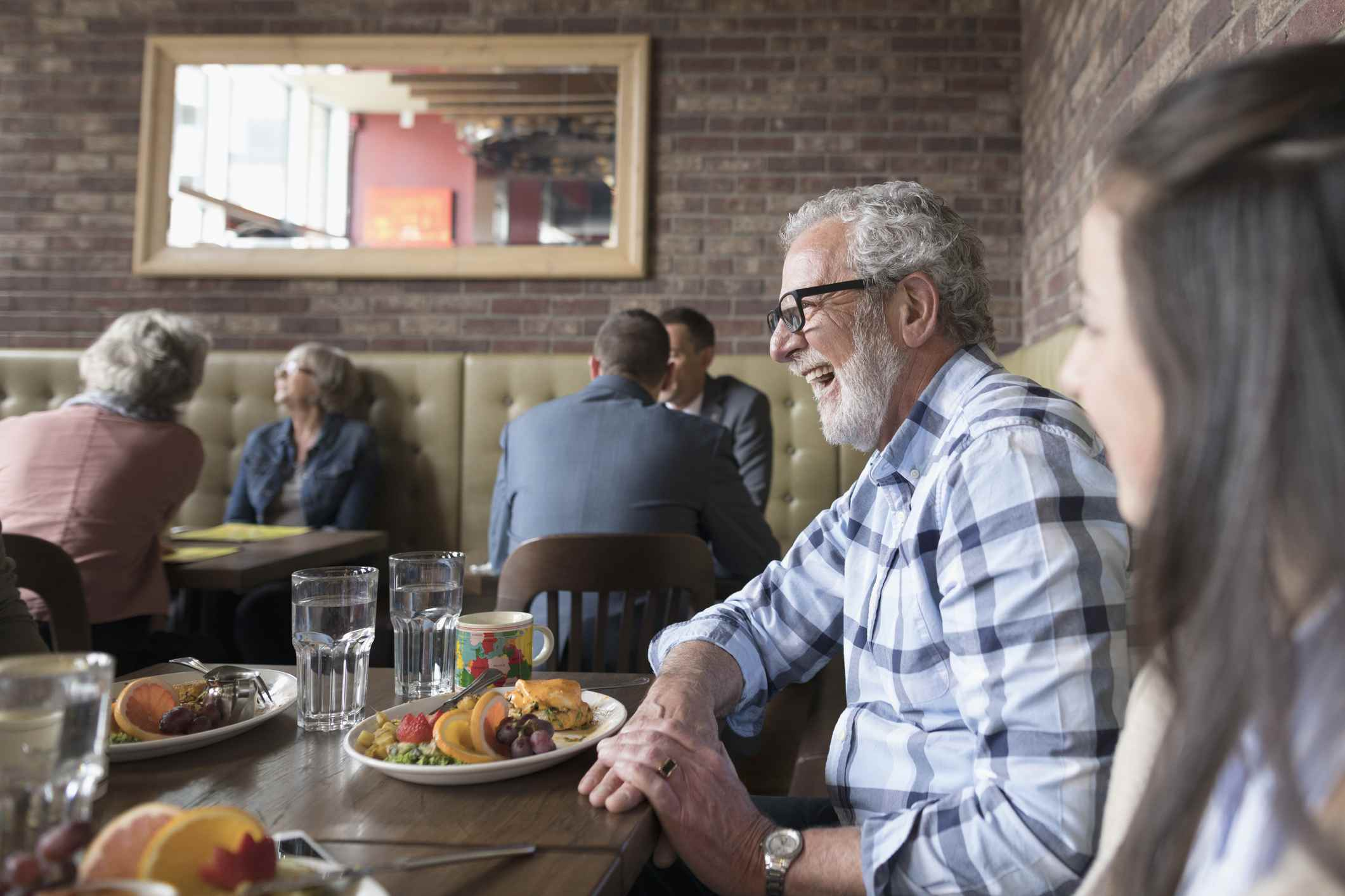 Man laughing in restaurant