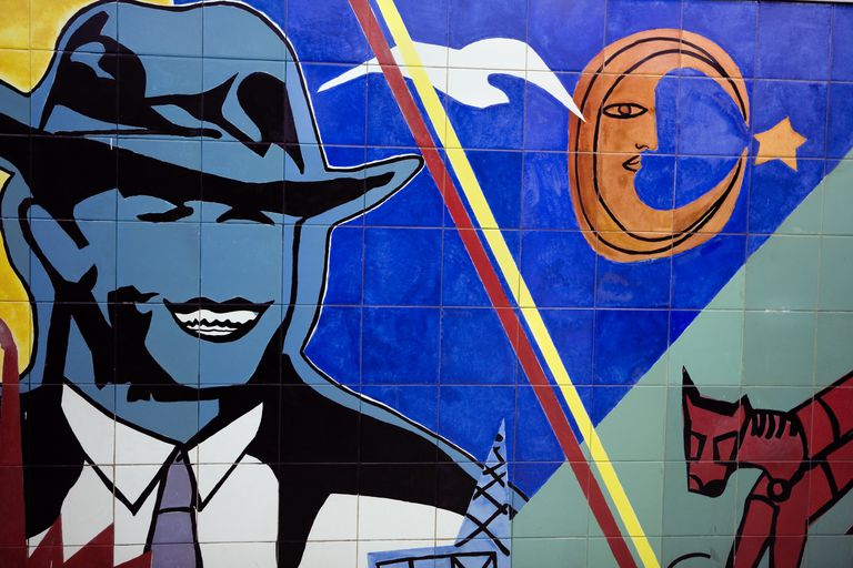 Colourful tiled mural at Carlos Gardel subway station.