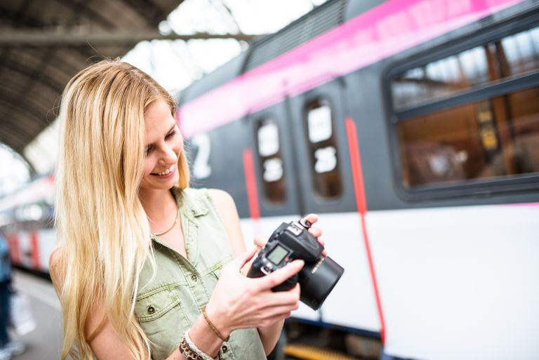 Woman looking through her vacation photos