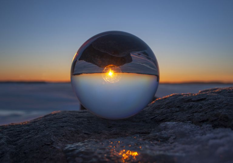 The sunset viewed through a glass orb