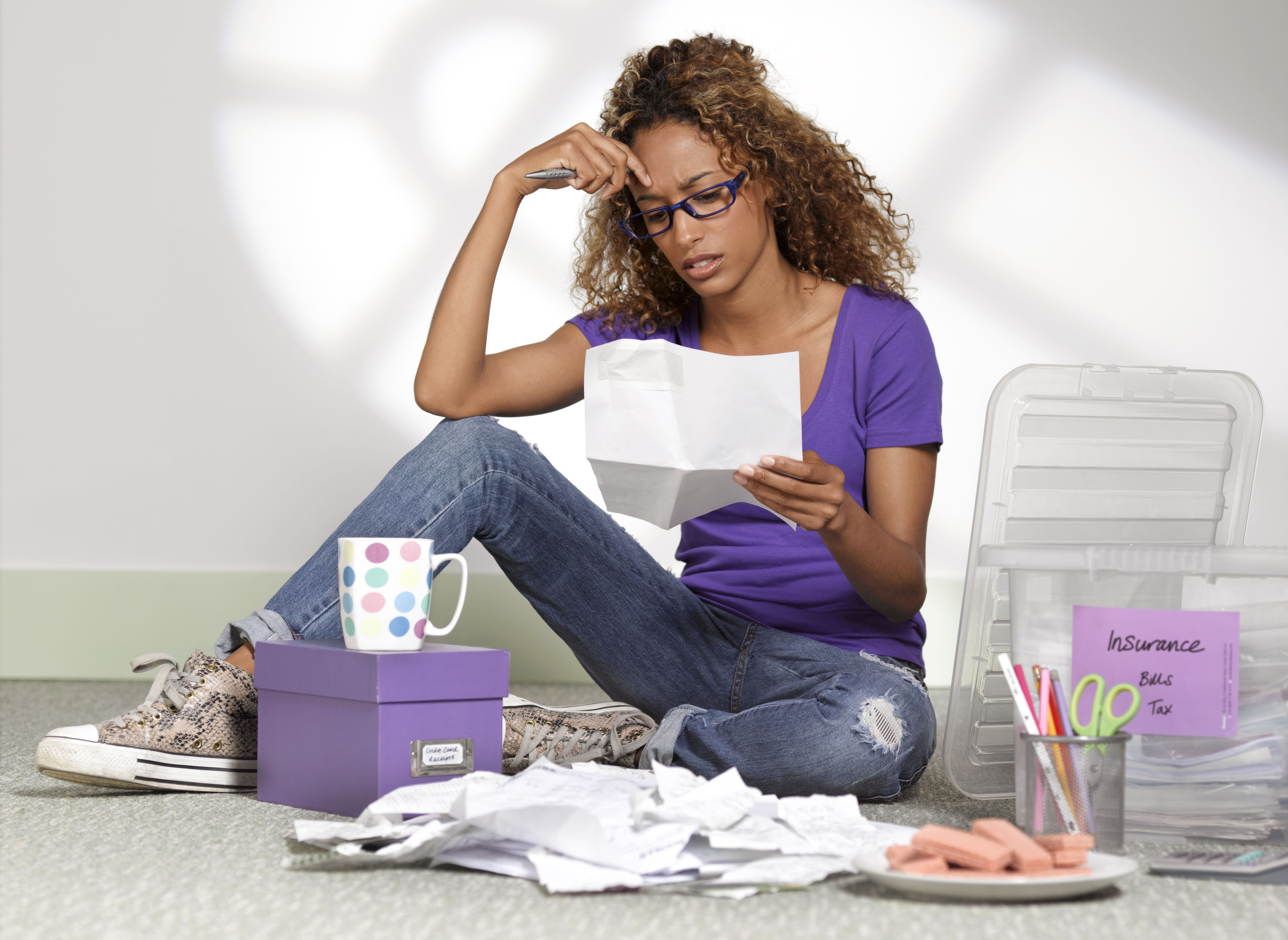 Young businesswoman with debts