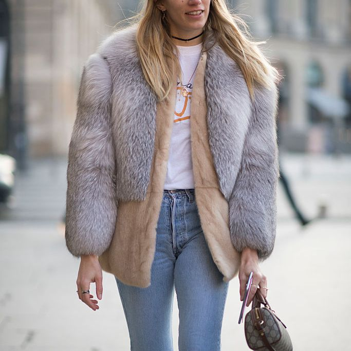 Street style fur coat and jeans