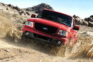 09 Ranger Sport 4x4 Truck driving through mud.