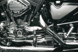 Close up, side view of a motorcycle's chrome engine and parts.