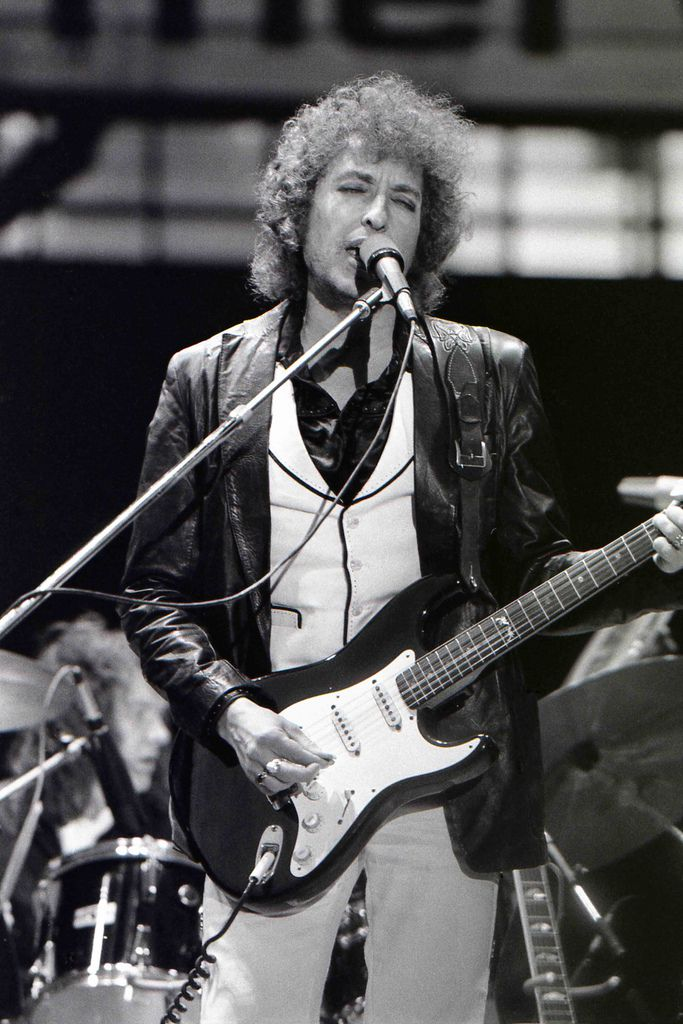 Bob Dylan playing an electric guitar