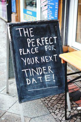 Text On Blackboard At Sidewalk Cafe