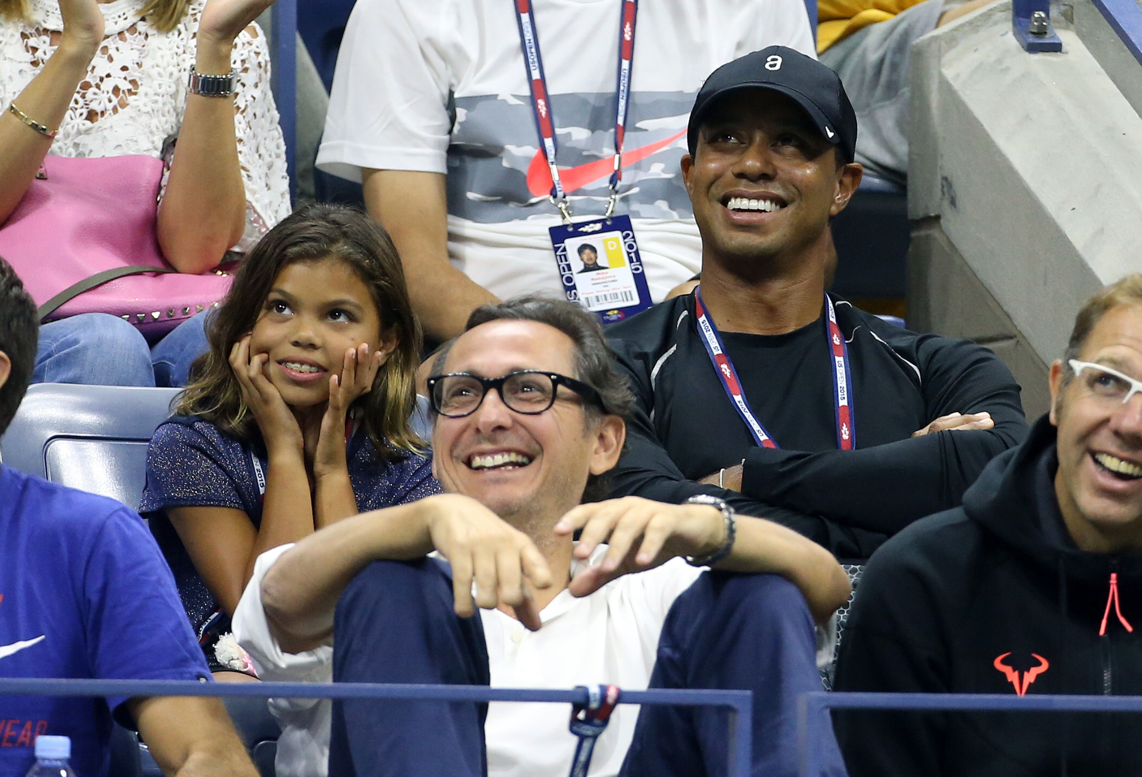 Tiger and daughter Sam smile when caught on camera while attending the 2015 US Open tennis championships