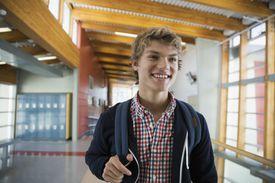 Smiling high school student in corridor
