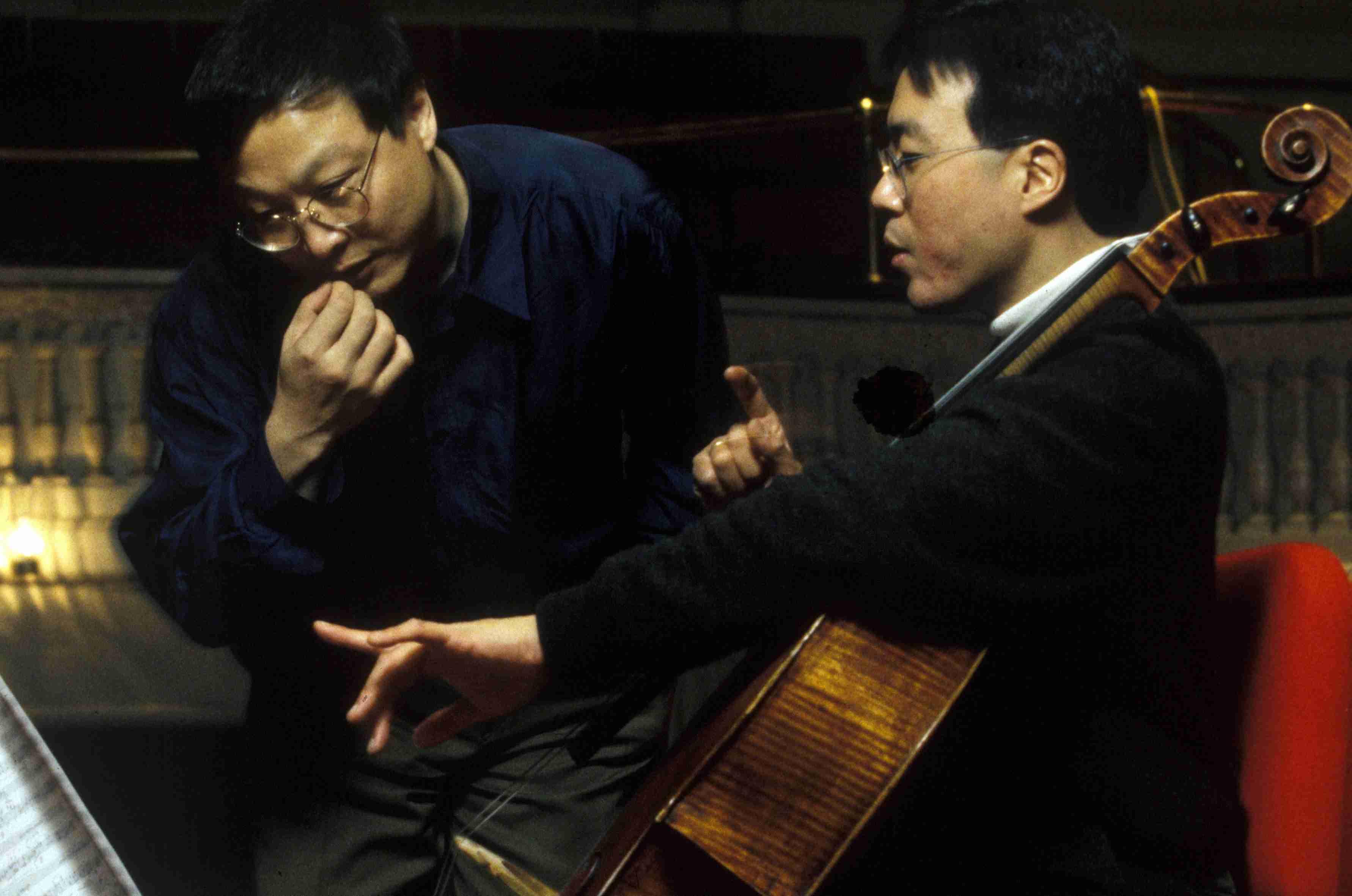 Yo-Yo Ma holding cello and Bright Sheng looking at sheet music
