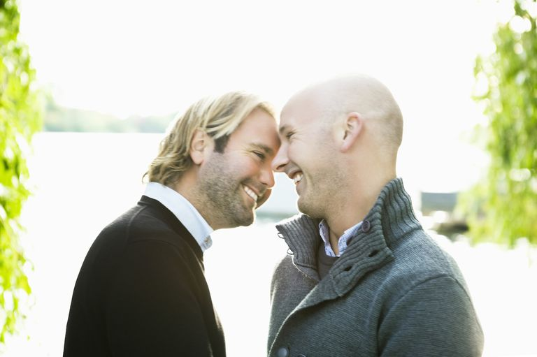 Gay Couple Smiling By The Water