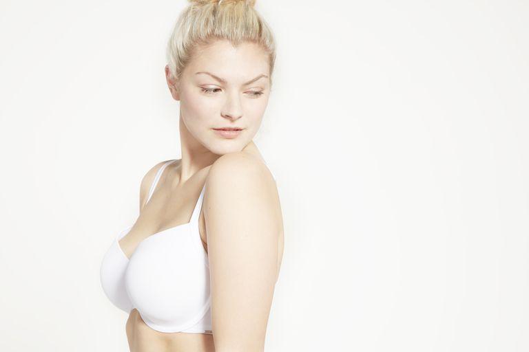 Model posing in white bra.