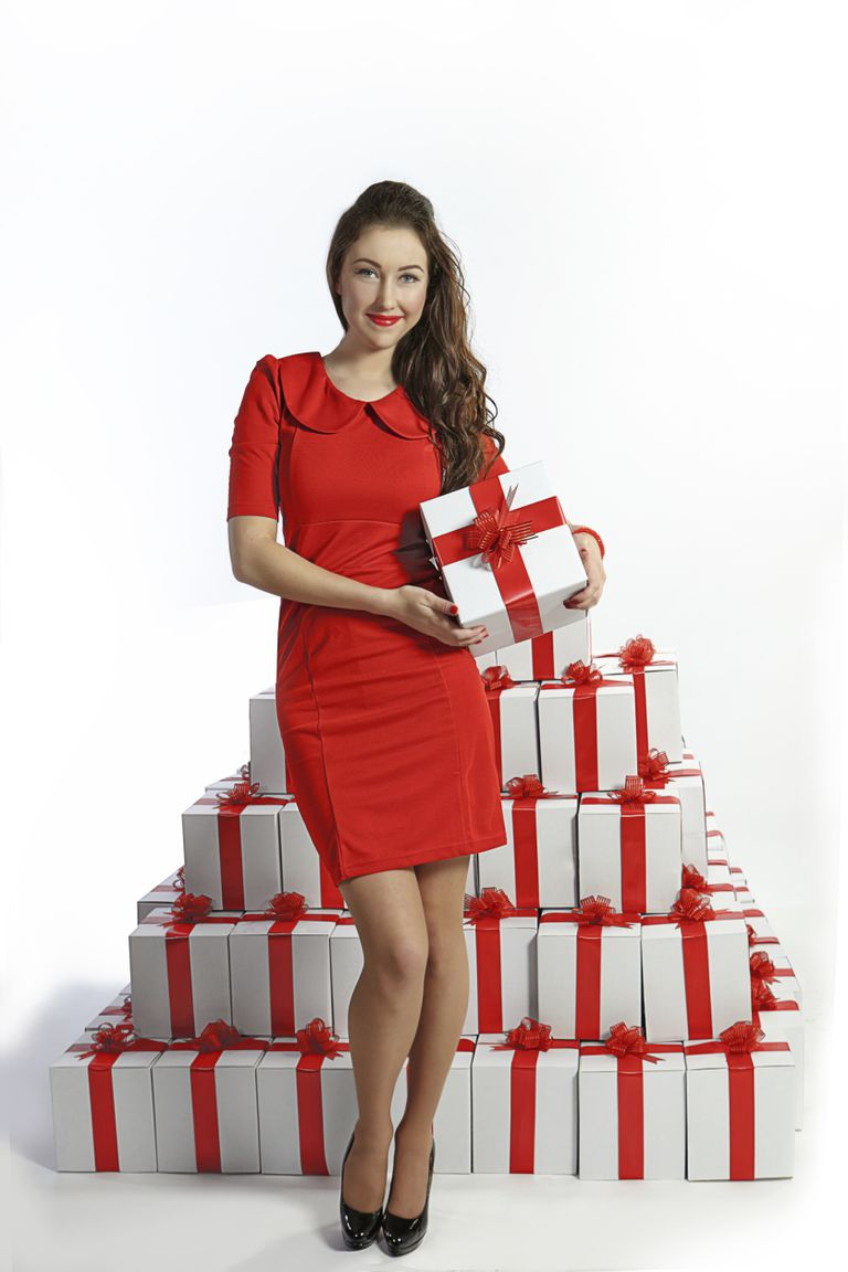 Photo of a woman with many gift boxes from About.com's Sweepstakes with Lots of Prizes list.