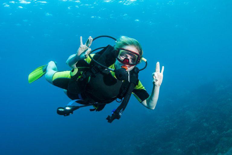 A scuba diver signalling OK